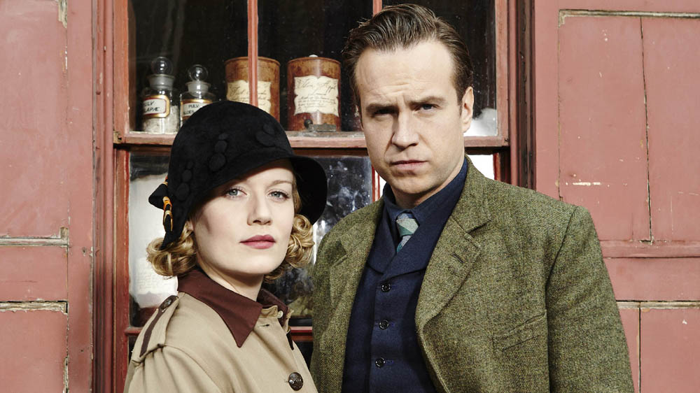 HARRY PRICE GHOST HUNTER RAFE SPALL as Harry Price and CARA THEOBALD as Sarah Grey