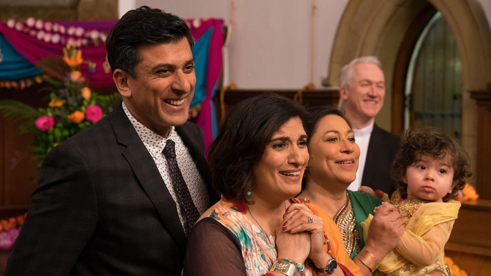 In the Club 2 6 Vinay (ACE BHATTI), Amita (MINA ANWAR), Sumita (SHAHEEN KHAN), Chaplain (GERARD FLETCHER), Baby Amber (EDISON WALKER)